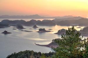 Islands at Sunset at Qiandaohu, 1000 Islands Lake, Lijiang, Yunnan, China, Asia by Andreas Brandl