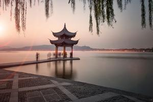 Visitors are Taking the Last Shots with a Pagoda at West Lake as the Sun Is Sinking by Andreas Brandl