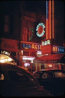 1945: a Night Image of Beef Steak Charlie's Restaurant on 50th and Broadway, New York, NY by Andreas Feininger