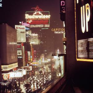 1945: Broadway Ave with Traffic and Neon Billboards Advertising Budweiser, New York, NY by Andreas Feininger