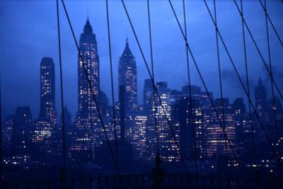1945: New York Skyline View During Twilight Hours by Andreas Feininger