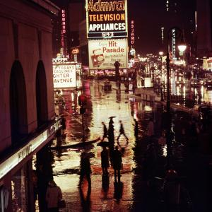 1945: Rainy Night in Times Square with Neon and Billboards, New York, NY by Andreas Feininger