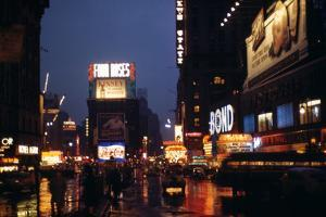1945: Times Square at Night after Rain, New York, NY by Andreas Feininger