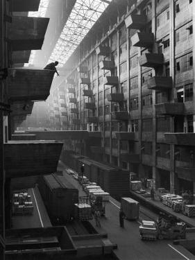 At Brooklyn Army Base Freight Is Lifted from Car to Jutting Loading Platforms by Andreas Feininger