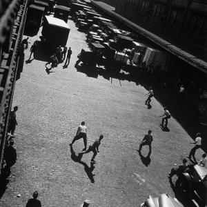 Boys Playing Game of Punch Ball Slap Ball Down by the Docks by Andreas Feininger