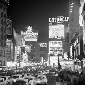 Brightly Lit Signs Shining over Traffic Going Down Broadway Towards Times Square by Andreas Feininger