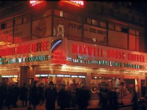 Busy Street Corner of Maxwell House and Mayflower Doughnuts Restaurant by Andreas Feininger