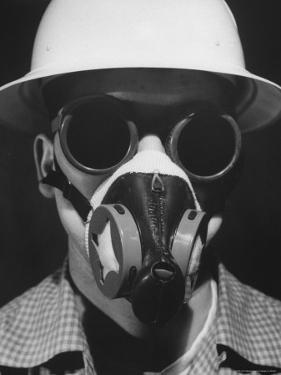 Closeup a A Man Wearing a Safety Helmet, Mask and Goggles by Andreas Feininger