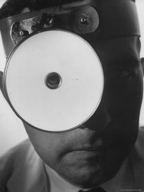 Closeup of a Doctor Wearing a Mask of His Profession by Andreas Feininger