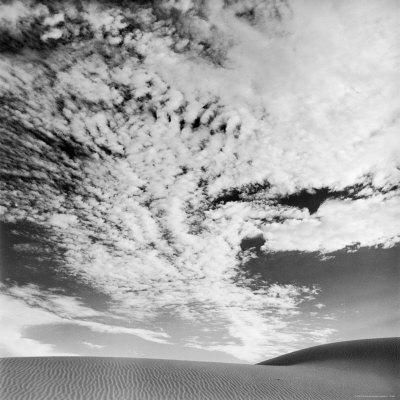 Cloud Covered Open Sky over Desert Landscape