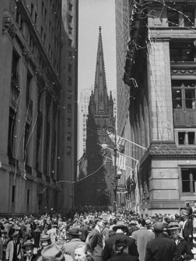 Confetti and Streamers Fly Down from Office Buildings, People Celebrating End of the War in Europe by Andreas Feininger