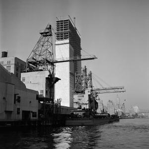Construction of the United Nations Building Along the East River by Andreas Feininger