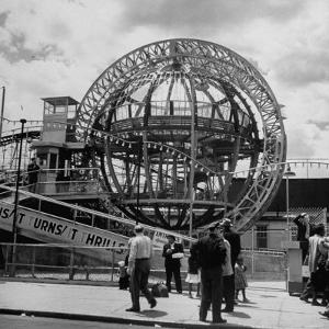 Gyro Globe Ride: Metal Monster Simultaneously Spins and Tilts Victims at Coney Island by Andreas Feininger