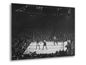 Joe Louis and Joe Walcott Boxing in Front of a Wide Eyed Crowd by Andreas Feininger