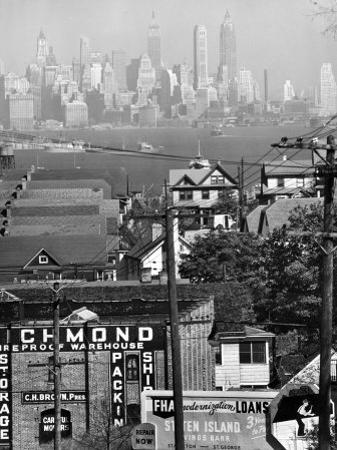 Lower Manhattan and Ferry Docks with Aid of a Telephoto Lens over the Rooftops in Staten Island by Andreas Feininger