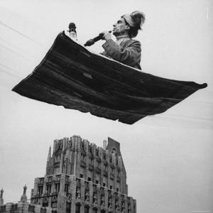 Man in Arabic Dress, Smoking a Water Cooled Pipe, is Comfortably Sitting on a Magic Carpet by Andreas Feininger