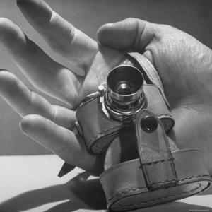 Micro Camera Resting in Palm of Hand by Andreas Feininger