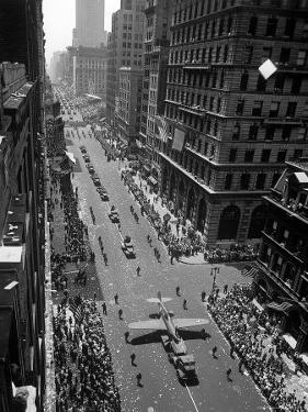 """Model of Plane on Float in """"New York at War"""" Independence Day Parade Up Fifth Avenue by Andreas Feininger"""