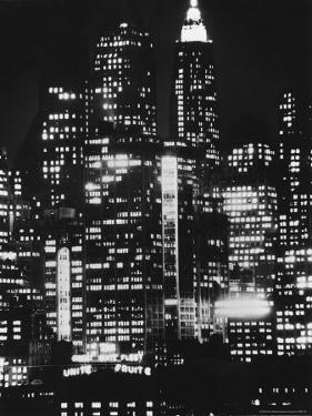 Nightime View of New York City Skyscrapers drom the Shores of New Jersey by Andreas Feininger