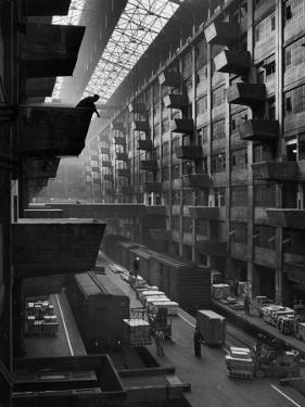 Off-Loaded Freight From Box Cars Being Hoisted Up to Jutting Loading Platforms, Brooklyn Army Base by Andreas Feininger