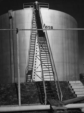 Oil Storage Tank at Standard Oil of Louisiana During WWII by Andreas Feininger