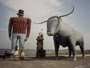 Painted Concrete Sculpture of Paul Bunyon and His Blue Ox, Babe Standing on Shores of Lake Bemidji by Andreas Feininger