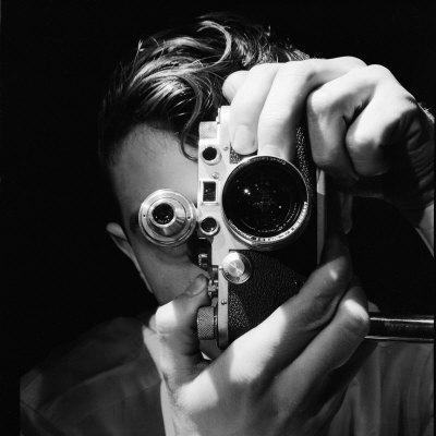 Person Holding Camera to Face. Winner of Life Photo Contest. We Do Not Have a Name