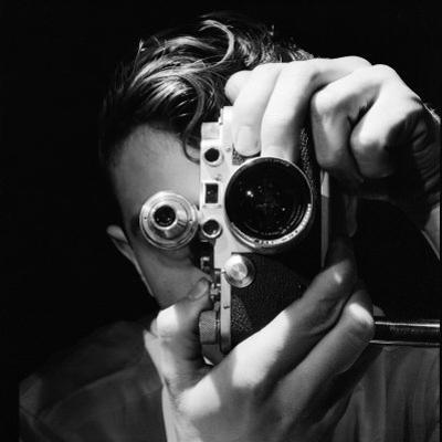 Person Holding Camera to Face. Winner of Life Photo Contest. We Do Not Have a Name by Andreas Feininger
