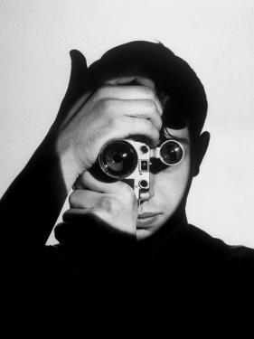 Photo Contest Winner Dennis Stock Holding Camera in Front of His Face by Andreas Feininger