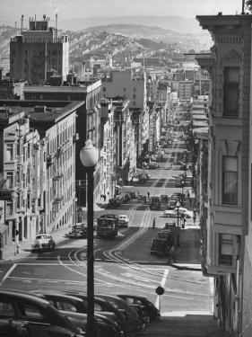 Picturesque View of Cable Car Coming Up the Hill in Light Auto Traffic by Andreas Feininger