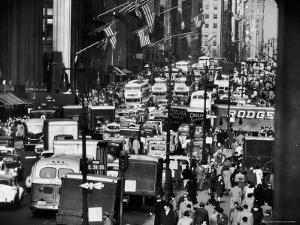 Pre-Christmas Holiday Traffic on 57th Avenue, Teeming with Double Decker Busses, Trucks and Cars by Andreas Feininger