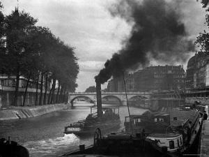 River Boat Smoke Passes along the River Seine by Andreas Feininger