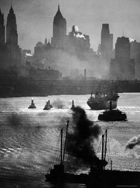 Ship and Tug Boat Traffic on the Hudson River with New York City Skyline by Andreas Feininger