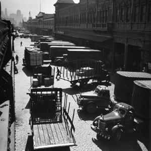 Trucks Clog Roadway in Front of Street-Level Entrances to Long Row of Hudson River Piers on West St by Andreas Feininger