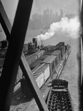 Tug Boats Muscling Barges Loaded with Lehigh Valley Railroad Freight Cars from New York City by Andreas Feininger