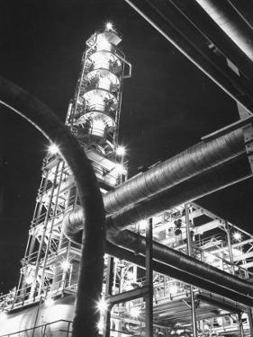 View of an Unidentified Refinery by Night by Andreas Feininger