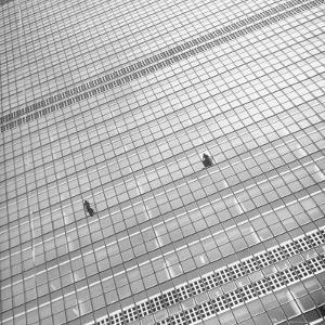 Window Cleaners Cleaning Windows High Up on the United Nations Building by Andreas Feininger