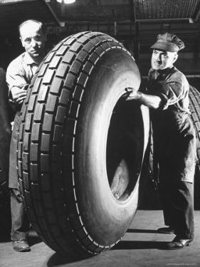 Workers with Truck Tires at Us Rubber Plant by Andreas Feininger