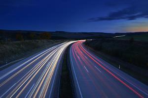 Germany, Thuringia, Close Saalburg, Tracer on the Freeway A9 at Night by Andreas Vitting