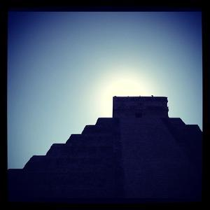 Chichen Itza Against a Backdrop of the Sky and Blazing Sun by Andrew Evans