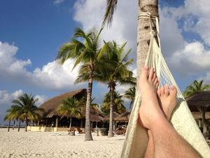 Relaxing in a Hammock on the Beach in Cozumel by Andrew Evans