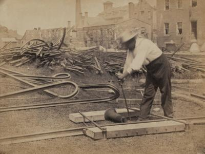 Railroad Construction Worker Straightening Track, c.1862