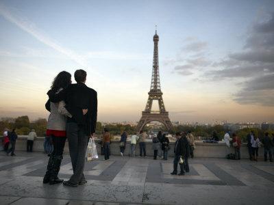 Couple Look Towards the Eiffel Tower, Paris, France, Europe