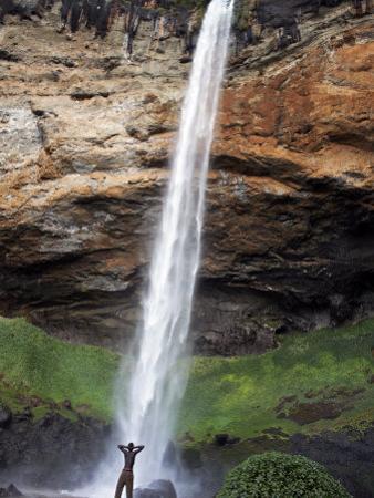 Man Looks Up at Sipi Falls, Uganda, East Africa, Africa