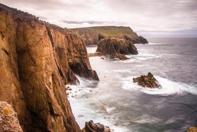Coastal scenery with Enys Dodnan rock formation at Lands End, England