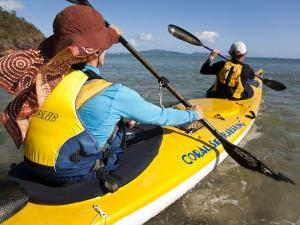 Women in Double Sea Kayak in Banksia Bay by Andrew Peacock