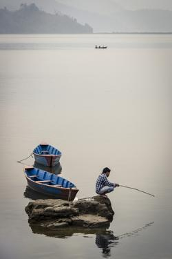A Man Fishing on Phewa Tal (Phewa Lake), Pokhara, Nepal, Asia by Andrew Taylor