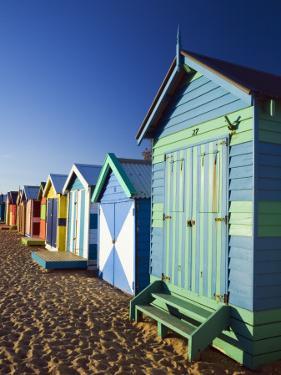 Australia, Victoria, Melbourne; Colourful Beach Huts at Brighton Beach by Andrew Watson