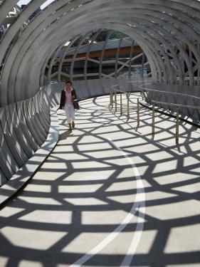 Australia, Victoria, Melbourne, Docklands; Pedestrian Crossing the Webb Dock Bridge by Andrew Watson