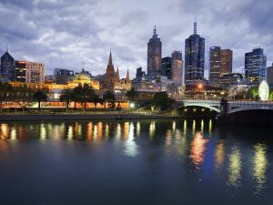 Australia, Victoria, Melbourne; Yarra River and City Skyline by Night by Andrew Watson